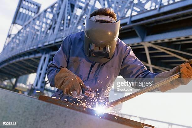 Person welding rod