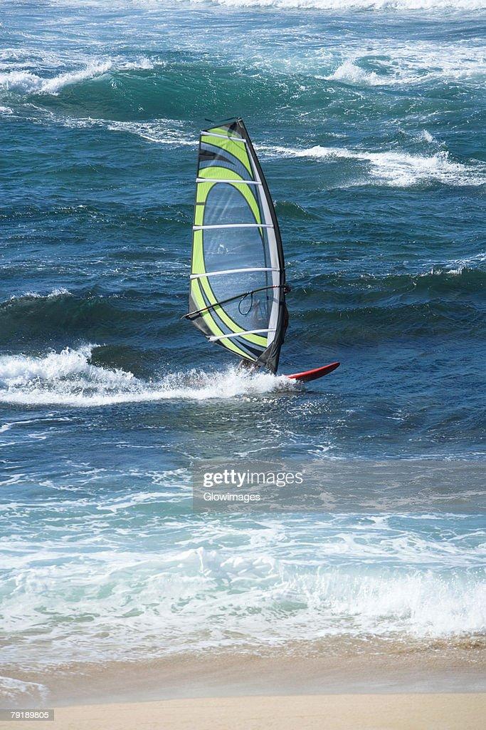 Person windsurfing in the sea, Hookipa Beach Park, Maui, Hawaii Islands, USA : Foto de stock