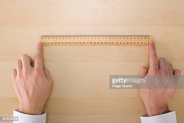 Person with a ruler