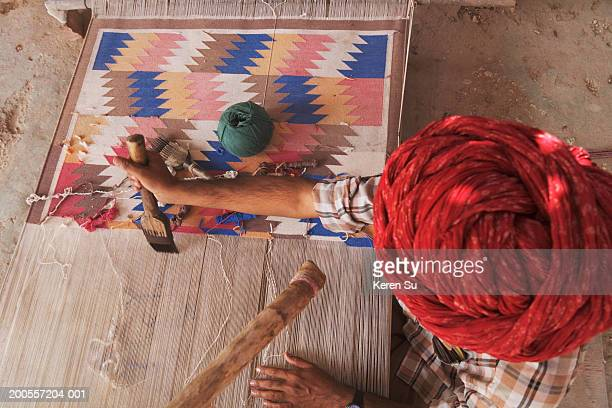 Person with cotton carpet in Weaving Burry