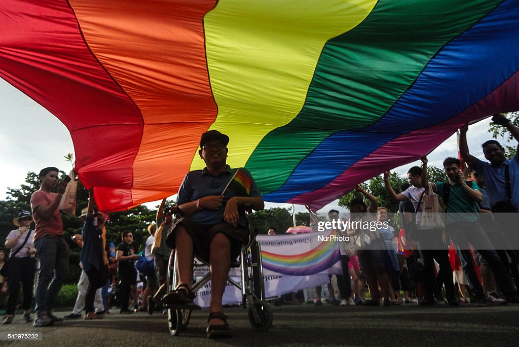 A person with disability participates in a LGBT pride parade at Rizal Park in Manila on Saturday, 25 June 2016. Hundreds of supporters and members of the lesbian, gay, bisexual, and transgender (LGBT) community paraded in Manila calling for the passage of an anti-discrimination law, as well as calling for justice for the shooting in a gay club in Orlando that left 53 people dead.
