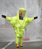 Person with yellow protective suit against chemical and bacteriological virus attacks