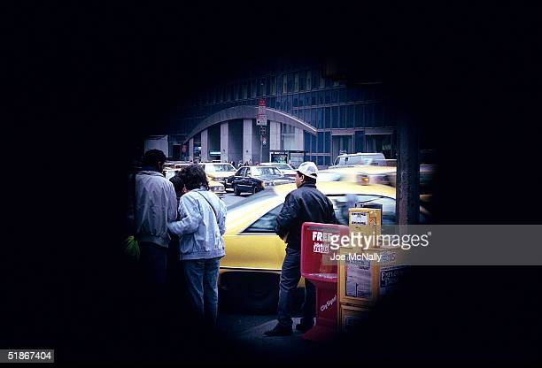 A person with retinitis pigmentosis or latestage glaucoma would see this 1992 New York City street scene like this