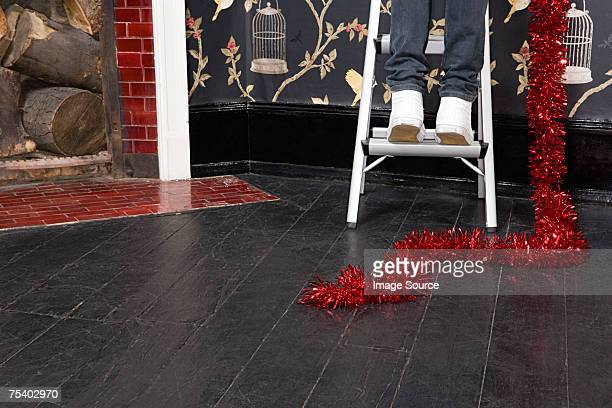 Person with tinsel