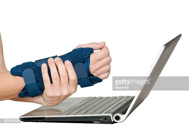 Person with wrist pain using a laptop