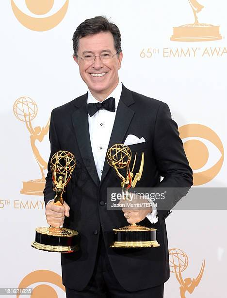 TV personaity Stephen Colbert winner of the Best Writing for a Variety Series Award and the Variety Series Award for 'The Colbert Report' poses in...