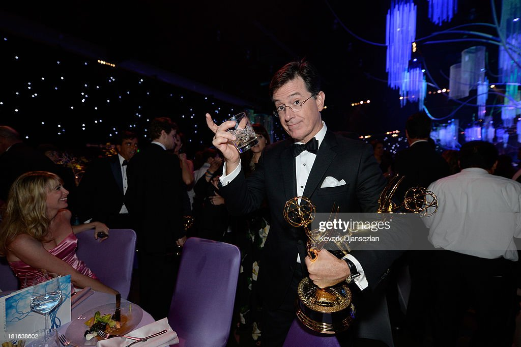 TV personaity <a gi-track='captionPersonalityLinkClicked' href=/galleries/search?phrase=Stephen+Colbert&family=editorial&specificpeople=215133 ng-click='$event.stopPropagation()'>Stephen Colbert</a>, winner of the Best Writing for a Variety Series Award and the Variety Series Award for 'The Colbert Report,' attends the Governors Ball during the 65th Annual Primetime Emmy Awards at Nokia Theatre L.A. Live on September 22, 2013 in Los Angeles, California.
