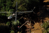 FEMA personal are hoisted into a UH60 Black Hawk during search grid flights by members of the 24 GSAB with the 4th ID of Fort Carson September 17...