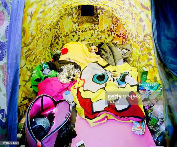 Personal belongings in tent at music festival