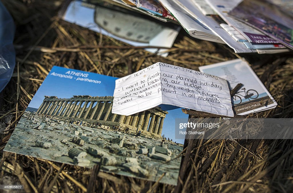 Personal items lie in a field amongst pieces of the wreckage of the Malaysia Airlines flight MH17 on July 24, 2014 in Petropavlivka, Ukraine. Malaysian Airlines flight MH17 was travelling from Amsterdam to Kuala Lumpur when it crashed in eastern Ukraine killing all 298 passengers. The aircraft was allegedly shot down by a missile and investigations continue to find the perpetrators of the attack.
