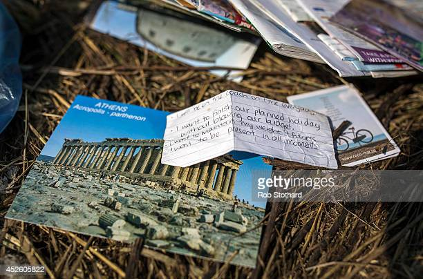 Personal items lie in a field amongst pieces of the wreckage of the Malaysia Airlines flight MH17 on July 24 2014 in Petropavlivka Ukraine Malaysian...