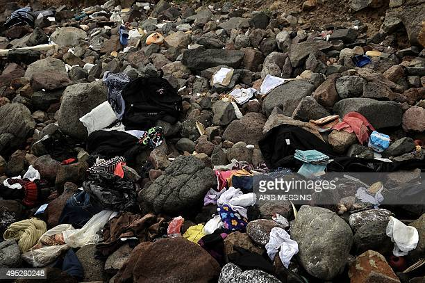 Personal items removed from bags belonging to shipwrecked migrants are scattered on a beach on the Greek island of Lesbos on November 1 2015 At least...