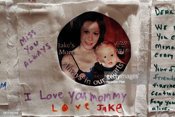A personal note to a young mother is displayed with other pictures of loved ones killed in the September 11 terrorist attacks that were made by...