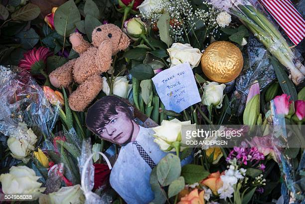 Personal notes and tributes to British rock icon David Bowie are seen outside his former home in Hauptstrasse 155 in Berlin on January 14 2016 David...