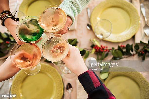 Personal perspective of people with martini glasses at festive table