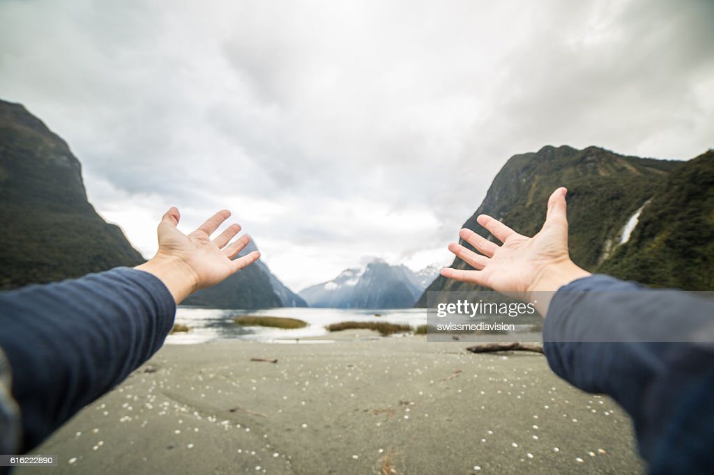Personal perspective of person embracing nature, mountain landscape : Stock Photo
