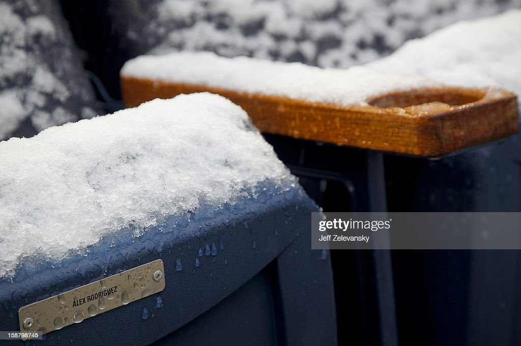 A personal seat of New York Yankees third baseman Alex Rodriguez is covered with snow before the New Era Pinstripe Bowl between West Virginia Mountaineers and the Syracuse Orange at Yankee Stadium on December 29, 2012 in the Bronx borough of New York City.