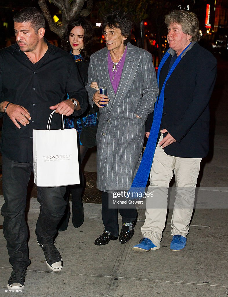 Personal security Vincent Guastamacchia, Sally Wood with musicians Ronnie Wood and Mick Taylor of the Rolling Stones seen outside the Gansevoort Hotel on November 7, 2013 in New York City.