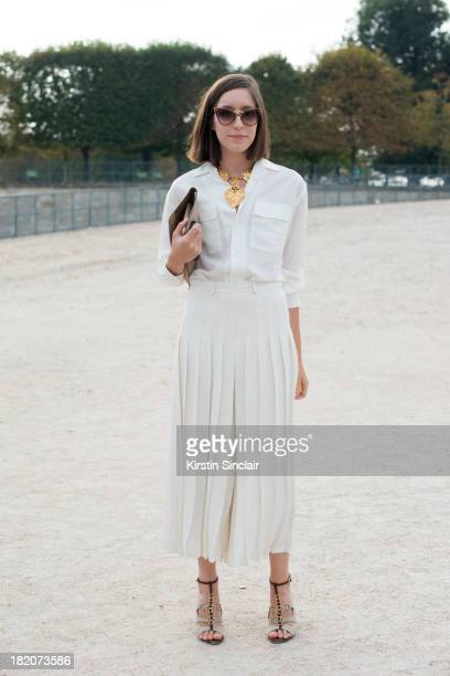 Personal shopper and freelance stylist Laetitia Roukbi wears Ralph Lauren top and culottes Max Mara shoes Delvaux bag YSL sunglasses and a Christian...