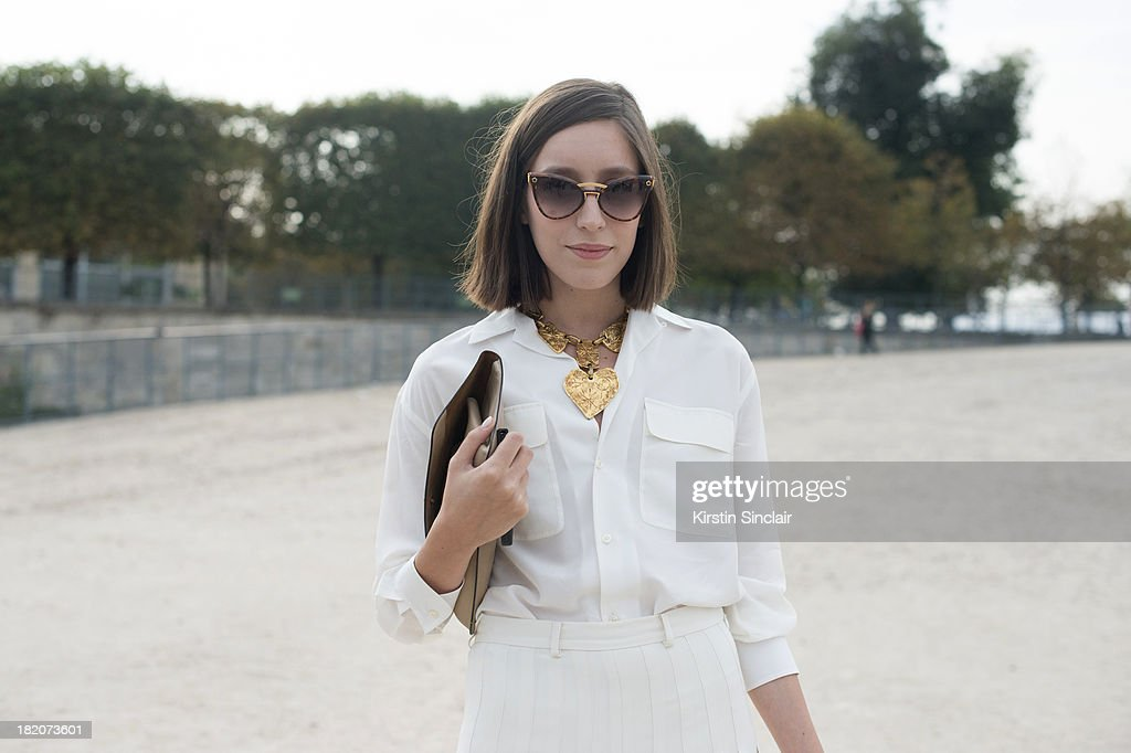 Personal shopper and freelance stylist Laetitia Roukbi wears Ralph Lauren top and culottes, Delvaux bag, YSL glasses and a Christian Lacroix necklace on day 3 of Paris Fashion Week Spring/Summer 2014, Paris September 26, 2013 in Paris, London.