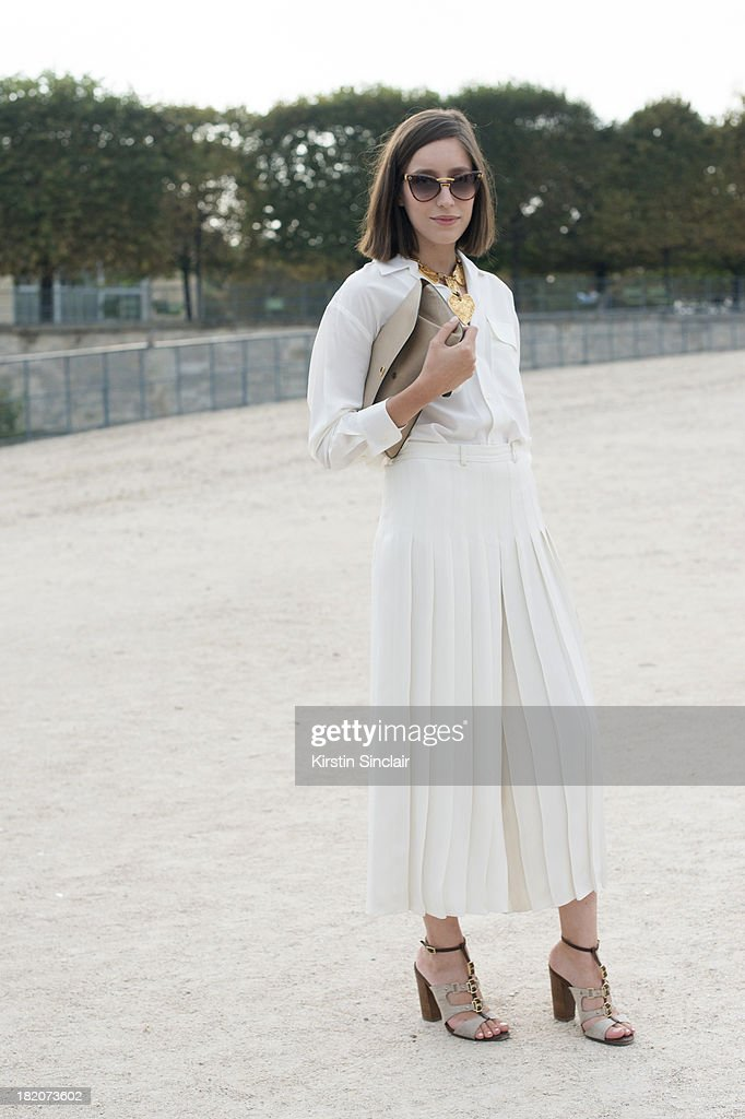 Personal shopper and freelance stylist Laetitia Roukbi wears Ralph Lauren top and culottes, Max Mara shoes, Delvaux bag, YSL sunglasses and a Christian Lacroix necklace on day 3 of Paris Fashion Week Spring/Summer 2014, Paris September 26, 2013 in Paris, London.