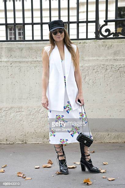 Personal Shopper Antonia Michalik wears a Nadya Dzialz hat blazer and dress Chanel shoes bag on day 6 during Paris Fashion Week Spring/Summer 2016/17...