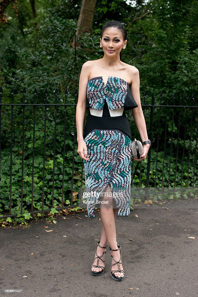 Personal stylist Karen Ng wears a Peter Pilotto dress and a Christian Louboutin clutch bag on day 3 of London Fashion Week Spring/Summer 2013, on September 15, 2013 in London, England.