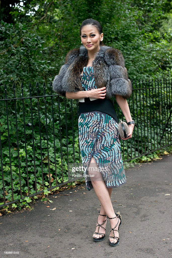 Personal stylist Karen Ng wears a Peter Pilotto dress, Prada shawl, Burberry shoes and a Christian Louboutin clutch bag on day 3 of London Fashion Week Spring/Summer 2013, on September 15, 2013 in London, England.