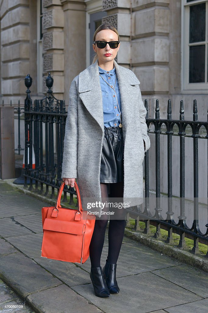 Personal Stylist writer and Blogger Danielle Ward wears Ray Ban sunglasses Topshop shirt and jewellery Zara shorts and bag and Mango shoes and Jacket...