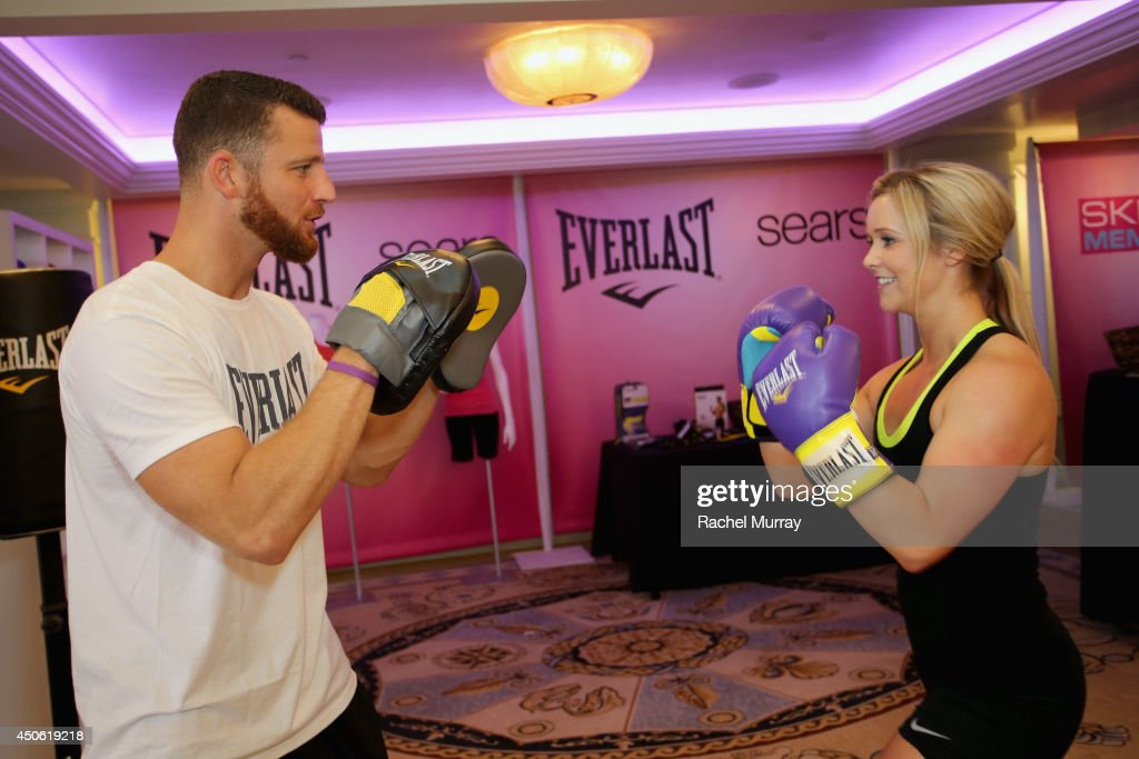 Personal trainer Kevan Watson (L) of Box 'N Burn and a member of The Shasta Skippers attend OK! Body & Soul 2014 at The Casa Del Mar Hotel on June 14, 2014 in Santa Monica, California.