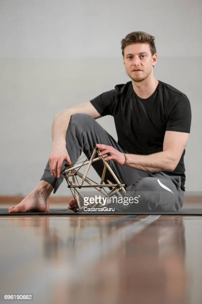 Personal Trainer Showing How  Tensegrity Icosahedron Affects The Entire Body