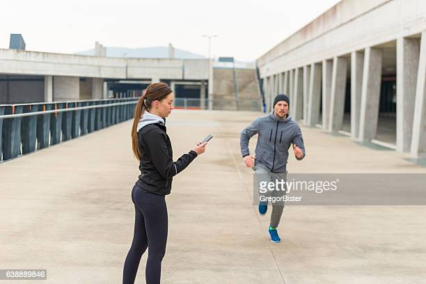 Personal trainer with stopwatch