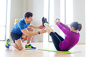 Personal trainer working with young woman.