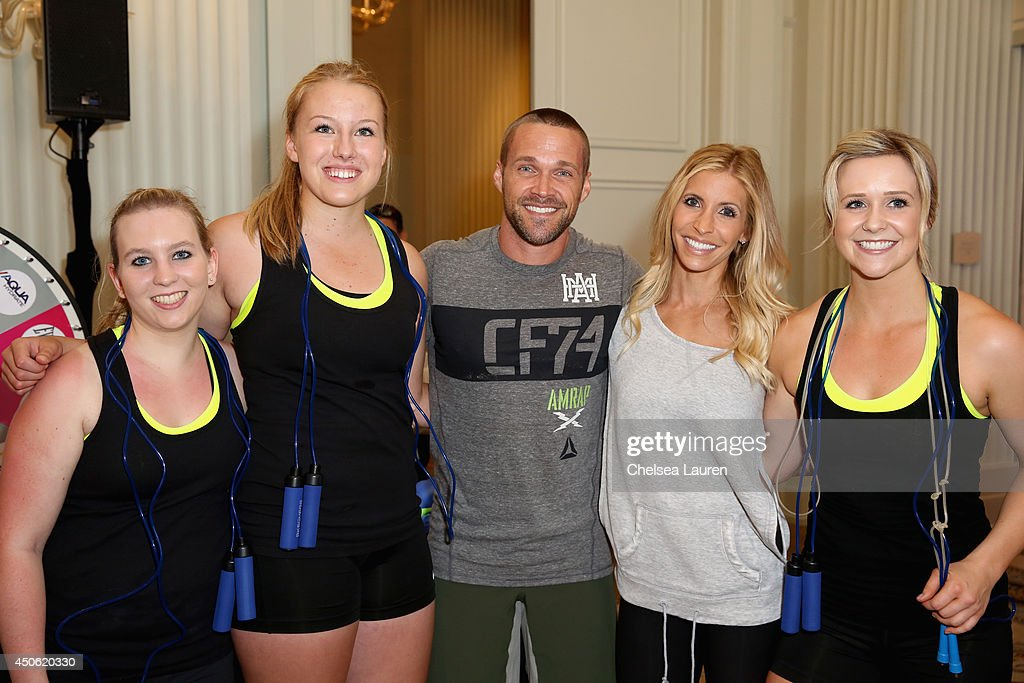 Personal trainers Chris Powell (center L) and Heidi Powell (center R) and The Shasta Skippers attend OK! Body & Soul 2014 at The Casa Del Mar Hotel on June 14, 2014 in Santa Monica, California.