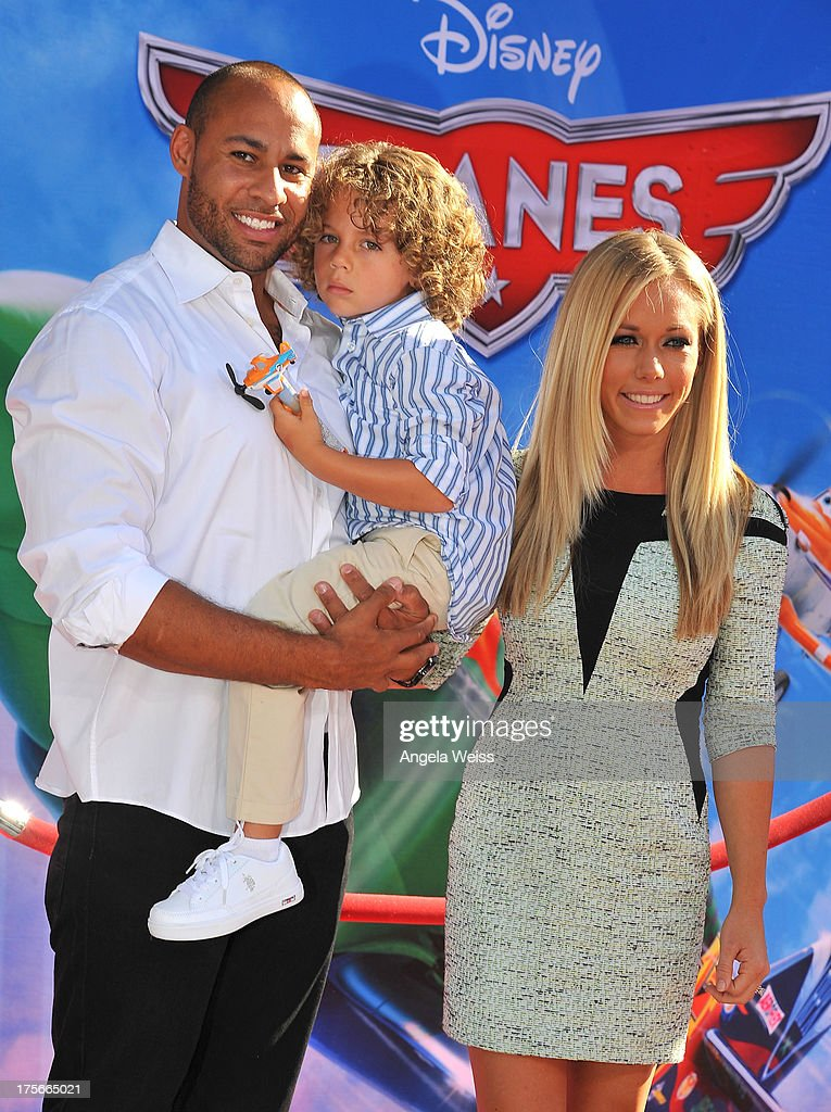 TV personalites Hank Baskett and Kendra Wilkinson Baskett with their son Hank Baskett IV attend the world-premiere of Disney's 'Planes' presented by Target at the El Capitan Theatre on August 5, 2013 in Hollywood, California.