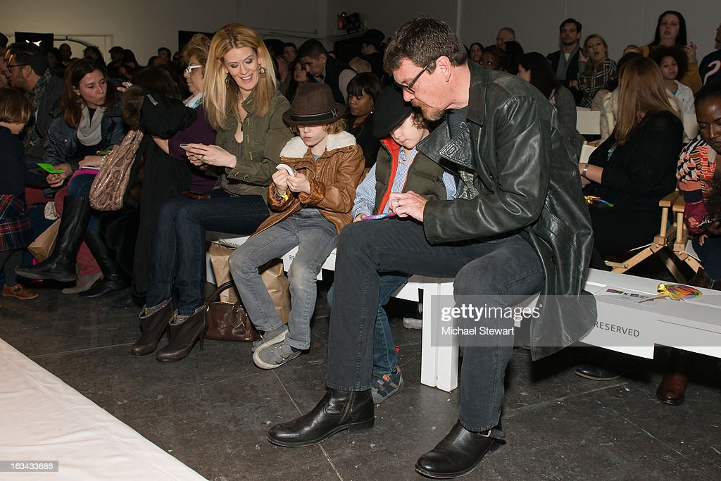 TV personalities Alex McCord (L) and Simon van Kempen with children attend the Diesel Kids fashion show during 2013 petitePARADE Kids Fashion Week at Industria Superstudio on March 9, 2013 in New York City.