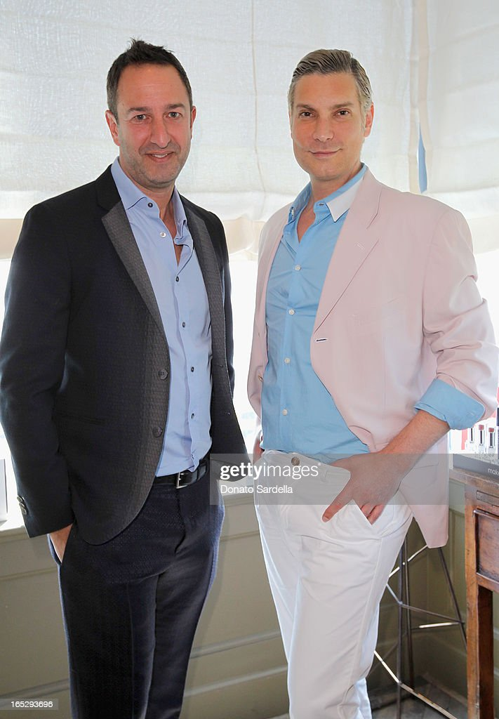 TV personalities and owners of Decades Christos Garkinos (L) and Cameron Silver attend the Rodial 10th Anniversary Luncheon on April 2, 2013 in West Hollywood, California.