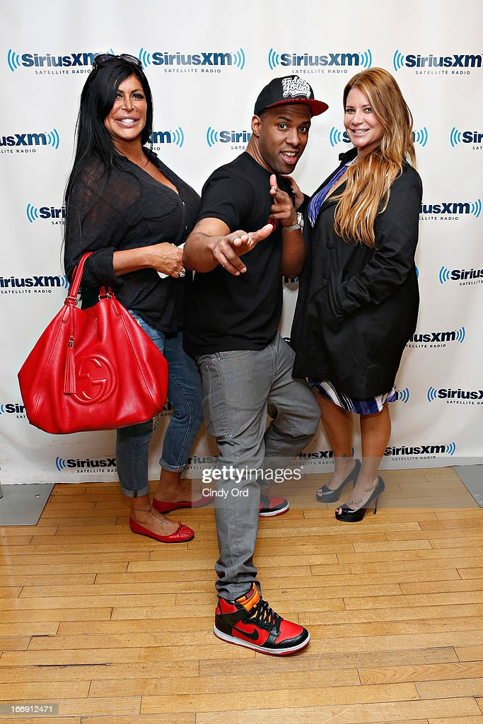 TV personalities Angela 'Big Ang' Raiola and Karen Gravano pose with SiriusXM host DJ Whoo Kid (C) at the SiriusXM Studios on April 18, 2013 in New York City.