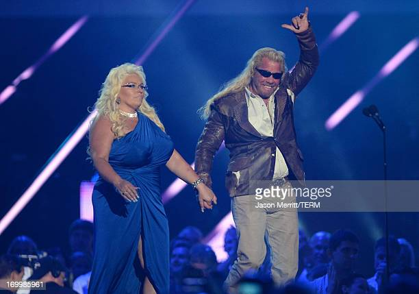 TV personalities Beth Chapman and Duane Dog Lee Chapman speak onstage during the 2013 CMT Music awards at the Bridgestone Arena on June 5 2013 in...