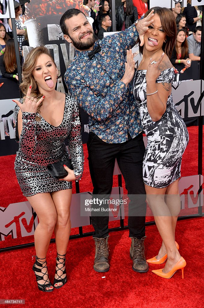 TV personalities Camila Nakagawa, Frank Sweeney and Aneesa Ferreira attend the 2014 MTV Movie Awards at Nokia Theatre L.A. Live on April 13, 2014 in Los Angeles, California.