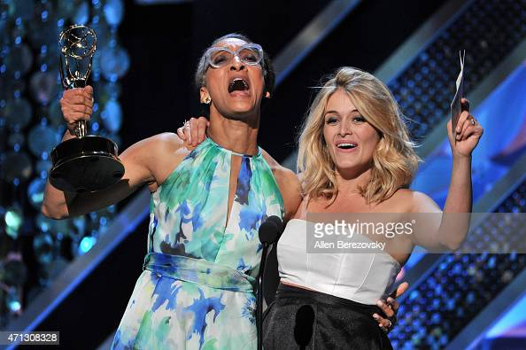 TV personalities Carla Hall and Daphne Oz accept the Outstanding Informative Talk Show Host award onstage during the 42nd Annual Daytime Emmy Awards...