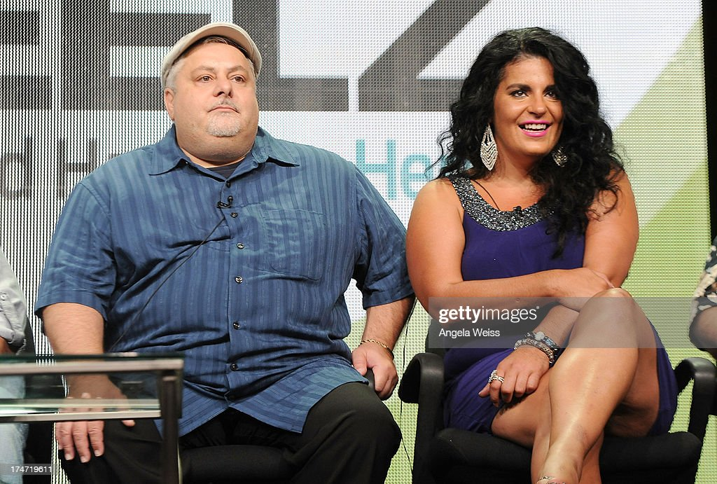 TV personalities Carmine Perelli and Madeline Santarelli speak onstage during 'The Capones' panel discussion at the ReelzChannel portion of the 2013 Summer Television Critics Association tour at The Beverly Hilton Hotel on July 28, 2013 in Beverly Hills, California.
