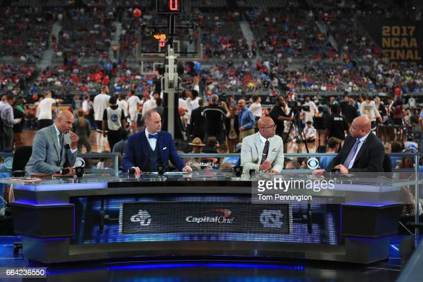 TV personalities Clark Kellogg Ernie Johnson Kenny Smith and Charles Barkley look on before the game between the Gonzaga Bulldogs and the North...