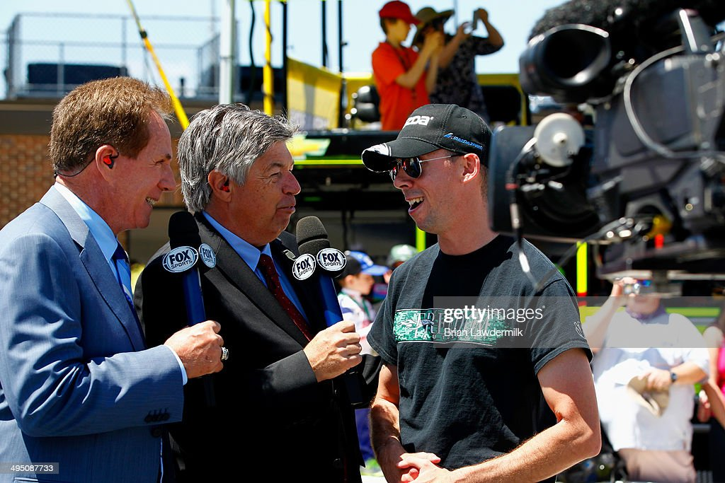 TV Personalities Darell Waltrip and Mike Joy interview U.S. Marine Staff Sgt. Liam Dwyer during pre-race ceremonies for the NASCAR Sprint Cup Series FedEx 400 Benefiting Autism Speaks at Dover International Speedway on June 1, 2014 in Dover, Delaware.