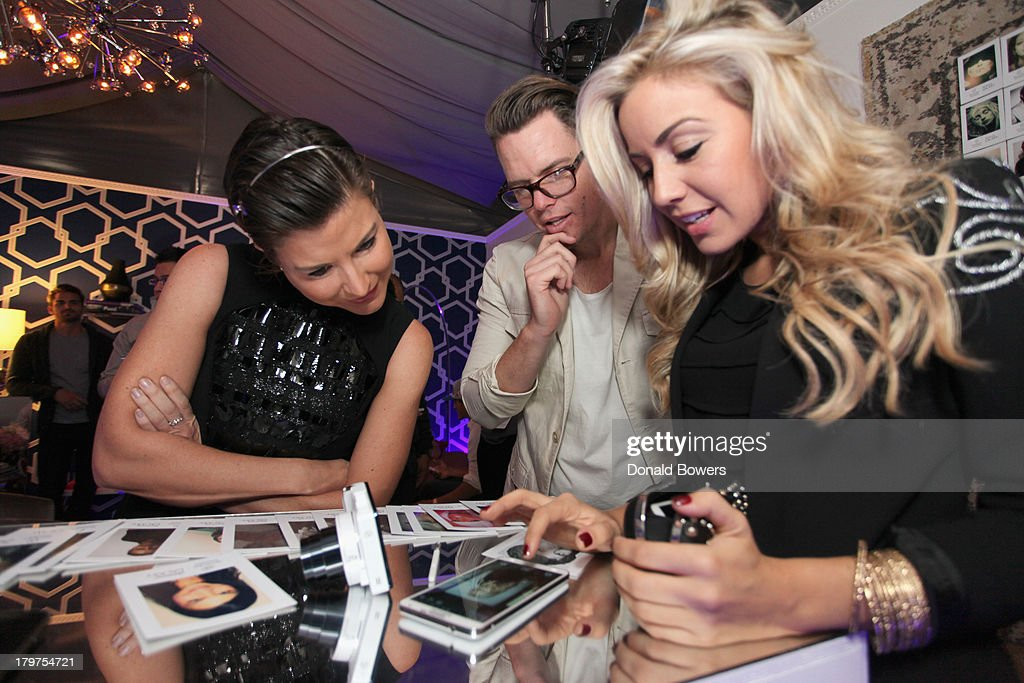 TV personalities <a gi-track='captionPersonalityLinkClicked' href=/galleries/search?phrase=Diem+Brown&family=editorial&specificpeople=962153 ng-click='$event.stopPropagation()'>Diem Brown</a> (L) and Ashley Kelsey (R) at The Samsung Galaxy Blue Room at Mercedes-Benz Fashion Week Spring 2014 Collections at Lincoln Center on September 6, 2013 in New York City.