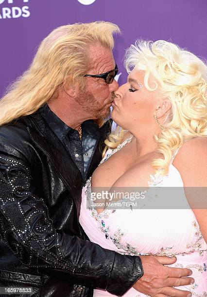 TV personalities Dog the Bounty Hunter and Beth Chapman arrive at the 48th Annual Academy of Country Music Awards at the MGM Grand Garden Arena on...