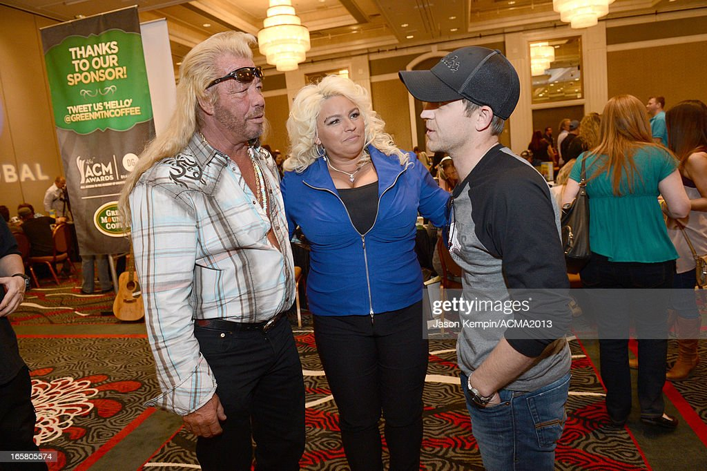 L-R) TV personalities Dog the Bounty Hunter, <a gi-track='captionPersonalityLinkClicked' href=/galleries/search?phrase=Beth+Chapman&family=editorial&specificpeople=2131379 ng-click='$event.stopPropagation()'>Beth Chapman</a>, and recording artist <a gi-track='captionPersonalityLinkClicked' href=/galleries/search?phrase=Justin+Moore&family=editorial&specificpeople=2437772 ng-click='$event.stopPropagation()'>Justin Moore</a> attend the Dial Global Radio Remotes during The 48th Annual Academy of Country Music Awards at the MGM Grand on April 5, 2013 in Las Vegas, Nevada.