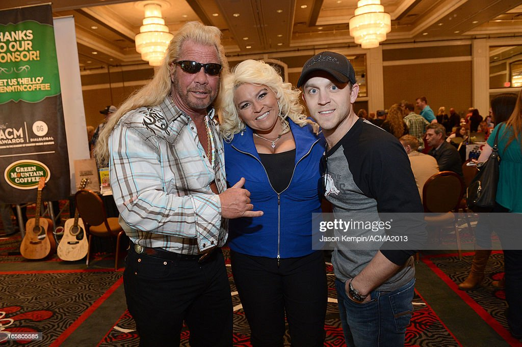 TV personalities Dog the Bounty Hunter, <a gi-track='captionPersonalityLinkClicked' href=/galleries/search?phrase=Beth+Chapman&family=editorial&specificpeople=2131379 ng-click='$event.stopPropagation()'>Beth Chapman</a>, and recording artist <a gi-track='captionPersonalityLinkClicked' href=/galleries/search?phrase=Justin+Moore&family=editorial&specificpeople=2437772 ng-click='$event.stopPropagation()'>Justin Moore</a> attend the Dial Global Radio Remotes during The 48th Annual Academy of Country Music Awards at the MGM Grand on April 5, 2013 in Las Vegas, Nevada.