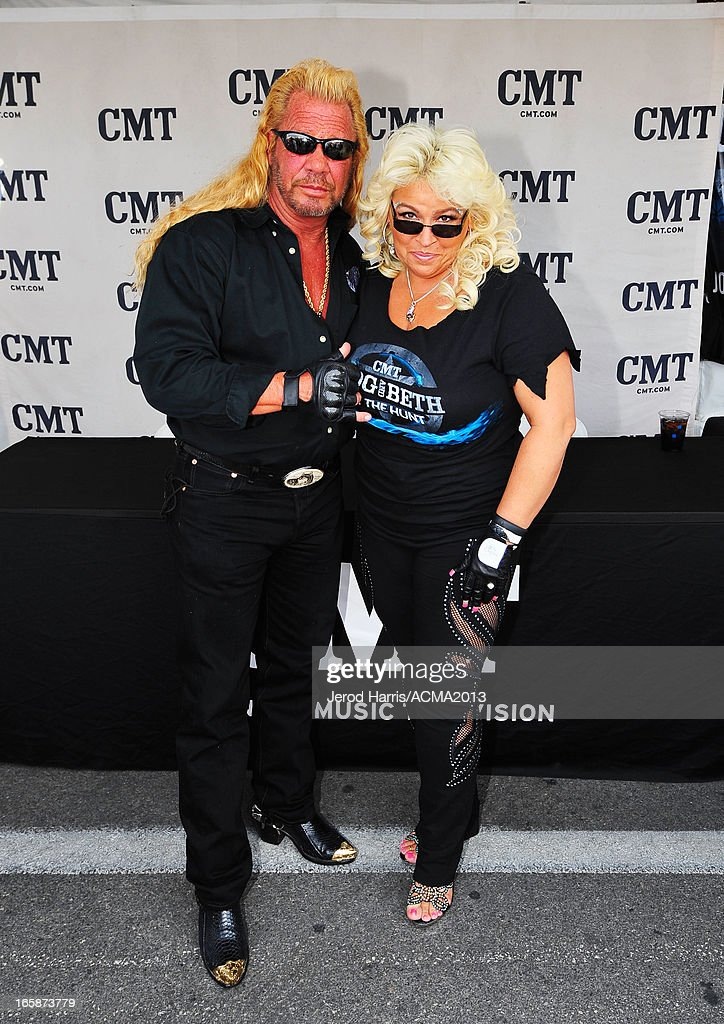 TV personalities Duane 'Dog' Chapman and <a gi-track='captionPersonalityLinkClicked' href=/galleries/search?phrase=Beth+Chapman&family=editorial&specificpeople=2131379 ng-click='$event.stopPropagation()'>Beth Chapman</a> attend The ACM Experience during the 48th Annual Academy of Country Music Awards at the Orleans Arena on April 6, 2013 in Las Vegas, Nevada.