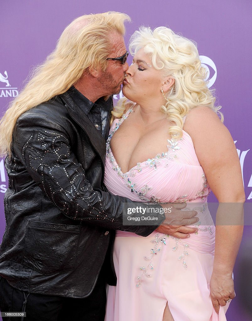 TV personalities Duane Lee 'Dog' Chapman and Beth Chapman of Dog the Bounty Hunter arrives at the 48th Annual Academy Of Country Music Awards at MGM Grand Garden Arena on April 7, 2013 in Las Vegas, Nevada.